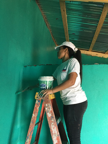 Painting the inside of the house green (the families wanted the house to resemble a rose).